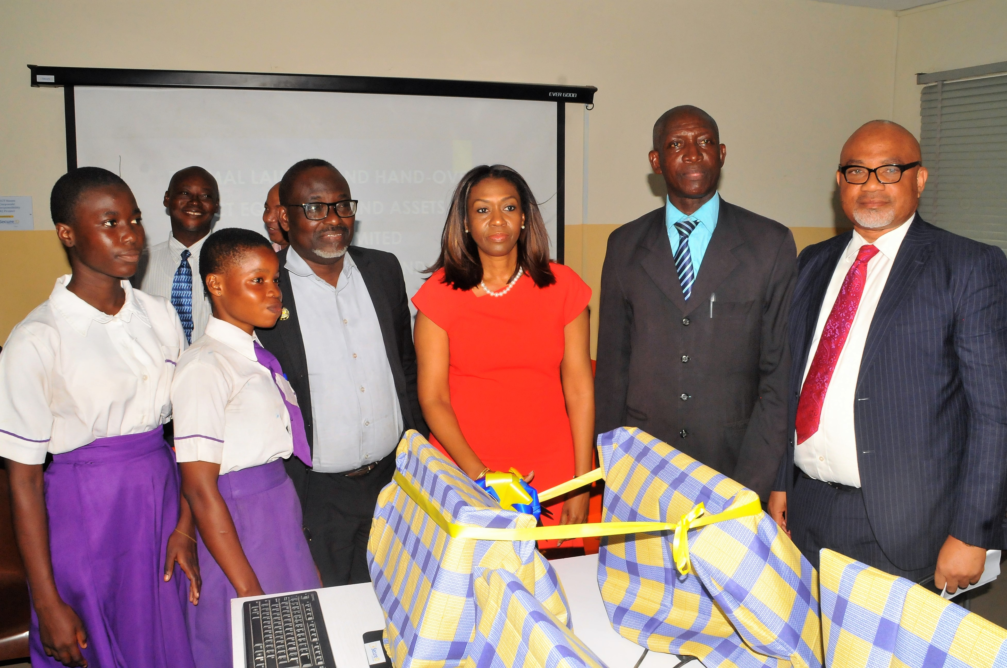 Managing Director/CEO, SecureID Limited, Mrs. Kofo Akinkugbe (3rd right), flanked by Principal, Ajumoni Senior Secondary School, Mushin, Mr. Benson Megbowon (2ND right); Board Director, SecureID Limited, Mr. Adeyinka Adeyemi (1ST right); Director, Schools Administration, Education District 6, Ministry of Education, Lagos State, Mr. Olubunmi Olukoya (3rd left) and students of Ajumoni Senior Secondary School, Mushin, at the CSR Launching and Hand-over of ICT Equipment and Assets donated by SecureID Limited to Ajumoni Senior Secondary School, Iyana-Isolo, Mushin, A Lagos State Government Secondary School.